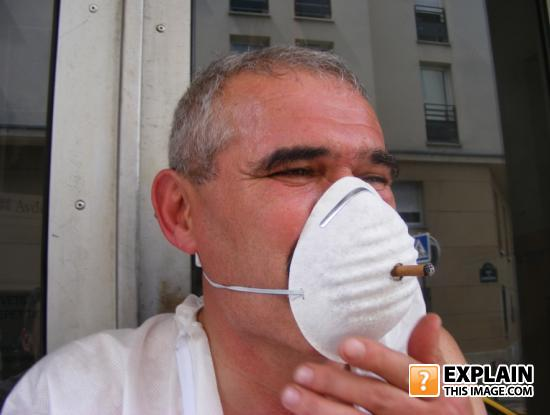 - Man can smoking with grippe protection